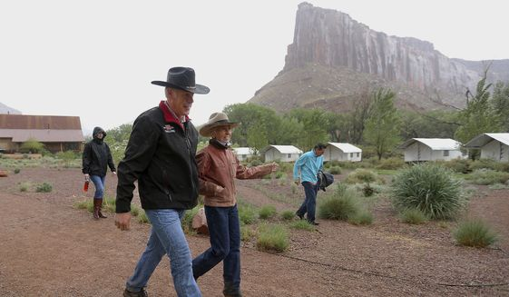 Interior Secretary Ryan Zinke talks with rancher Heidi Redd after a morning hike at the Dugout Ranch in the Indian Creek region of the Bears Ears National Monument, Utah, Tuesday, May 9, 2017. Opponents and supporters of the national monument have jockeyed for position with Zinke on his four-day visit to Utah. (Scott G Winterton/The Deseret News via AP)