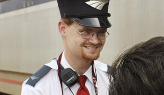 This Aug. 21, 2007, file photo shows Amtrak assistant conductor Brandon Bostian outside a train at the Amtrak station in St. Louis. (Huy Richard Mach/St. Louis Post-Dispatch via AP, File)