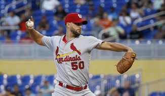 St. Louis Cardinals' Adam Wainwright delivers a pitch during the first inning of a baseball game against the Miami Marlins, Tuesday, May 9, 2017, in Miami. (AP Photo/Wilfredo Lee)