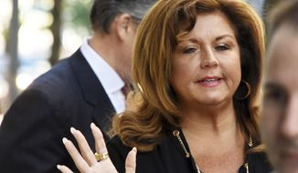 """Abby Lee Miller arrives at the Joseph F. Weis Jr. U.S. Courthouse Tuesday, May 9, 2017,  in Pittsburgh, for the second day of her sentencing hearing. A federal judge is expected to sentence the former """"Dance Moms"""" reality TV star for bankruptcy fraud and bringing $120,000 worth of Australian currency into the country without reporting it.  (Darrell Sapp//Pittsburgh Post-Gazette via AP)"""