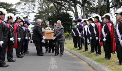 FILE - In this June 4, 2016, photo, the Knights of Columbus, Yerba Buena Lodge of San Francisco, stand guard as the casket, holding the body of a girl found in May 2016 and buried in San Francisco, is carried to her new grave at Greenlawn Memorial Park Cemetery in Colma, Calif. The girl who died in 1876 and was found last year inside a small metal casket under a San Francisco home has been identified. The nonprofit Garden of Innocence project said Tuesday, May 9, 2017, that the child was 2-year-old Edith Howard Cook, who died on Oct. 13, 1876. (Michael Macor/San Francisco Chronicle via AP, File)