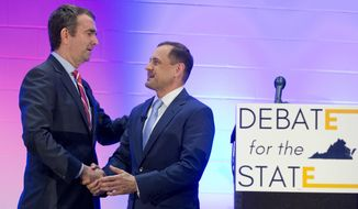 Democratic Gubernatorial candidates Lt. Gov. Ralph Northam, left, and former Congressman Tom Perriello, right, shake hands after a debate at a Union hall in Richmond, Va., Tuesday, May 9, 2017. The two candidates face off in the June 13th primary. (AP Photo/Steve Helber)