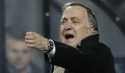 In this Thursday, Nov. 28, 2013 file image AZ's coach Dick Advocaat gives directions to his players during the Europa League Group L soccer match between AZ Alkmaar and Maccabi Haifa FC at AFAS stadium in Alkmaar, Netherlands. The Dutch soccer association has announced Tuesday May 9, 2017, that Dick Advocaat will be appointed for his third stint in charge of the national team. (AP Photo/Peter Dejong)
