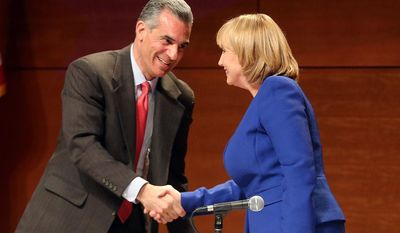 Assemblyman Jack Ciattarelli, left, and Lt. Gov. Kim Guadagno, Republicans running to succeed New Jersey Gov. Chris Christie, shake hands as they participate in their first primary debate Tuesday, May 9, 2017, at Stockton University in Galloway, N.J. (Dale Gerhard/The Press of Atlantic City via AP)