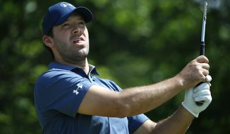 Former Dallas Cowboys quarterback Tony Romo watches his tee shot on the 8th tee box during U.S. Open Local Qualifying at Split Rail Links & Golf Club in Aledo, Texas, Monday, May 8, 2017. (Jae S. Lee/The Dallas Morning News via AP)