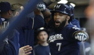 Milwaukee Brewers' Eric Thames celebrates his two-run home run with teammates during the first inning of a baseball game against the Boston Red Sox Tuesday, May 9, 2017, in Milwaukee. (AP Photo/Morry Gash)