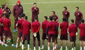 Atletico de Madrid head coach Diego Pablo Simeone, up center, gestures during a training session ahead of Wednesday's Champions League semifinal, 2nd leg soccer match between Atletico de Madrid and Real Madrid, in Madrid, Spain, Tuesday, May 9, 2017 . (AP Photo/Daniel Ochoa de Olza)