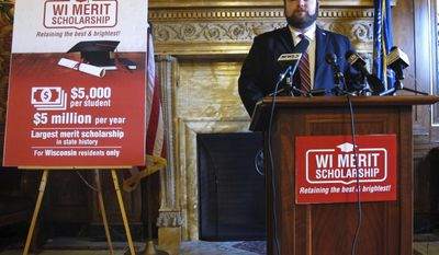 Wisconsin state Rep. Tyler August, R-Lake Geneva, discusses a bill he is co-sponsoring to create new $5,000 merit-based scholarships for state residents who attend University of Wisconsin schools on Tuesday, May 9, 2017, in Madison, Wis. (AP Photo/Scott Bauer)