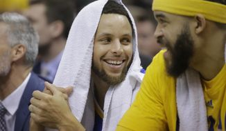 Golden State Warriors' Stephen Curry, left, and JaVale McGee (1) share a laugh as they sit on the bench at the end of the second half during Game 4 of the NBA basketball second-round playoff series against the Utah Jazz Monday, May 8, 2017, in Salt Lake City. The Warriors completed a second-round sweep of the Utah Jazz with a 121-95 victory. (AP Photo/Rick Bowmer)