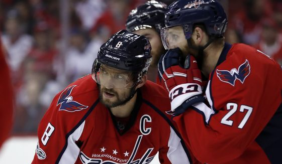 Washington Capitals left wing Alex Ovechkin (8), from Russia, listens to Washington Capitals defenseman Karl Alzner (27) during the first period of Game 7 in an NHL Stanley Cup Eastern Conference semifinal hockey game against the Pittsburgh Penguins, Wednesday, May 10, 2017, in Washington. (AP Photo/Alex Brandon)