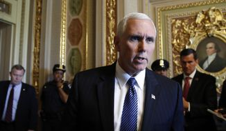 """Vice President Mike Pence talks to reporters about the firing of FBI Director James Comey by President Donald Trump on Capitol Hill in Washington, Wednesday, May 10, 2017.    Pence is defending the firing of FBI Director Comey, saying the """"president made the right decision at the right time."""" He said Comey's firing was not related to the investigation into possible contacts between the Trump presidential campaign and Russia. (AP Photo/Jacquelyn Martin)"""