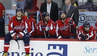 FILE - In this May 13, 2009, file photo, Washington Capitals left wing Alex Ovechkin, left, of Russia, sits on the boards in the finals seconds of Game 7 of the team's NHL hockey second-round playoff series against the Pittsburgh Penguins in Washington. The Penguins won 6-2, eliminating the Capitals from the playoffs. Another Game 7 for the Washington Capitals. Another step into the breach for a fan base snakebitten by decades of missed opportunities. The Capitals face the Pittsburgh Penguins in a Game 7 Wednesday night, May 10. (AP Photo/Pablo Martinez Monsivais, File)