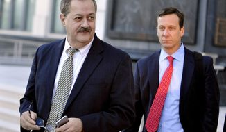 FILE - In a Tuesday, Nov. 24, 2015, file photo, former Massey Energy CEO Don Blankenship, left, walks out of the Robert C. Byrd U.S. Courthouse after the jury deliberated for a fifth full day in his trial, in Charleston, W. Va. Blankenship is finishing up his one-year federal prison sentence related to the deadliest U.S. mine explosion in four decades. According to the U.S. Bureau of Prisons website, Blankenship is set to be released Wednesday, May 10, 2017, from a halfway house in Phoenix. He must serve one year of supervised release. (AP Photo/Chris Tilley, File)