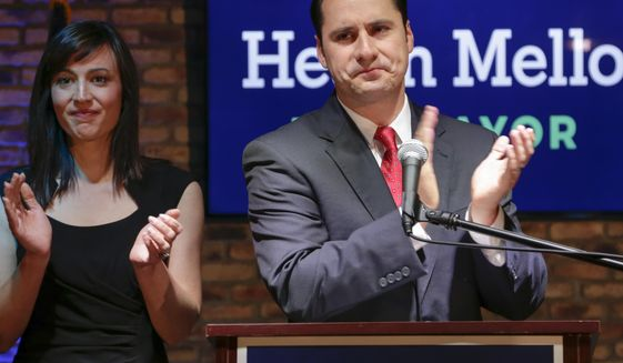 With wife Catherine by his side, Democratic mayoral candidate Heath Mello concedes the election to the incumbent, Republican Omaha mayor Jean Stothert, in Omaha, Neb., Tuesday, May 9, 2017. The race has drawn national attention as Democrats seek new energy given huge Republican gains in local, state and federal offices across the country. (AP Photo/Nati Harnik)