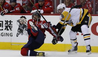 Washington Capitals left wing Alex Ovechkin (8), from Russia, is taken to the ice by Pittsburgh Penguins defenseman Brian Dumoulin (8) during the second period of Game 7 in an NHL hockey Stanley Cup Eastern Conference semifinal, Wednesday, May 10, 2017, in Washington. (AP Photo/Alex Brandon)