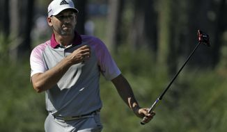 Sergio Garcia, of Spain, reacts as he putts on the 12th green during a practice round for The Players Championship golf tournament Wednesday, May 10, 2017, in Ponte Vedra Beach, Fla. (AP Photo/Chris O'Meara)