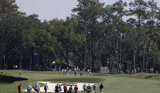 Golfers head up the 12th fairway towards the green during a practice round for The Players Championship golf tournament Wednesday, May 10, 2017, in Ponte Vedra Beach, Fla. Course designers have shortened the length on the hole making it reachable off the drive. (AP Photo/Chris O'Meara)
