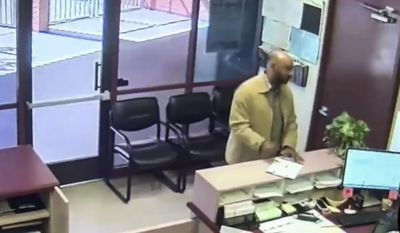In this image made from surveillance video provided by the San Bernardino Police via the San Bernardino City Unified School District, Cedric Anderson walks into North Park Elementary before he opened fire in a classroom in San Bernardino, Calif. The video released Wednesday, May 10, 2017, shows Anderson strolling into the school office at the elementary school on April 10 before killing his estranged wife and an 8-year-old boy. (San Bernardino Police/San Bernardino City Unified School District via AP)
