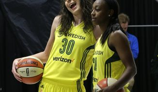 In this photo taken May 2, 2017, Seattle Storm forward Breanna Stewart (30) and guard Jewell Loyd (24) react as they pose for WNBA basketball official photos during the team's annual media day, Tuesday, May 2, 2017, in Seattle. The whirlwind has stopped for Breanna Stewart. After a much needed break, Stewart is ready for her second season with the Seattle Storm. (AP Photo/Ted S. Warren)