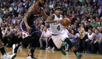 Boston Celtics guard Isaiah Thomas (4) drives to the basket past Washington Wizards forward Markieff Morris (5) during the second quarter of Game 5 of an NBA basketball second-round playoff series, in Boston, Wednesday, May 10, 2017. (AP Photo/Charles Krupa)