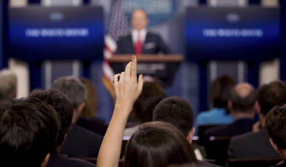 A reporters raises their hand as White House press secretary Sean Spicer talks to the media during the daily press briefing at the White House in Washington, Wednesday, May 3, 2017. Spicer discussed health care and FBI Director James Comey, comments made by Hillary Clinton and other topics. (AP Photo/Andrew Harnik)