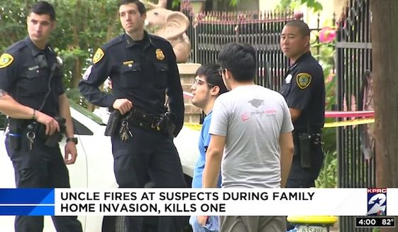 Houston residents speaks with police after four armed men broke into their home on May 9, 2017. A relative who lives on the street saw the ordeal unfold and opened fire with his personal handgun, killing one and injuring another. (NBC-2 Houston screenshot)