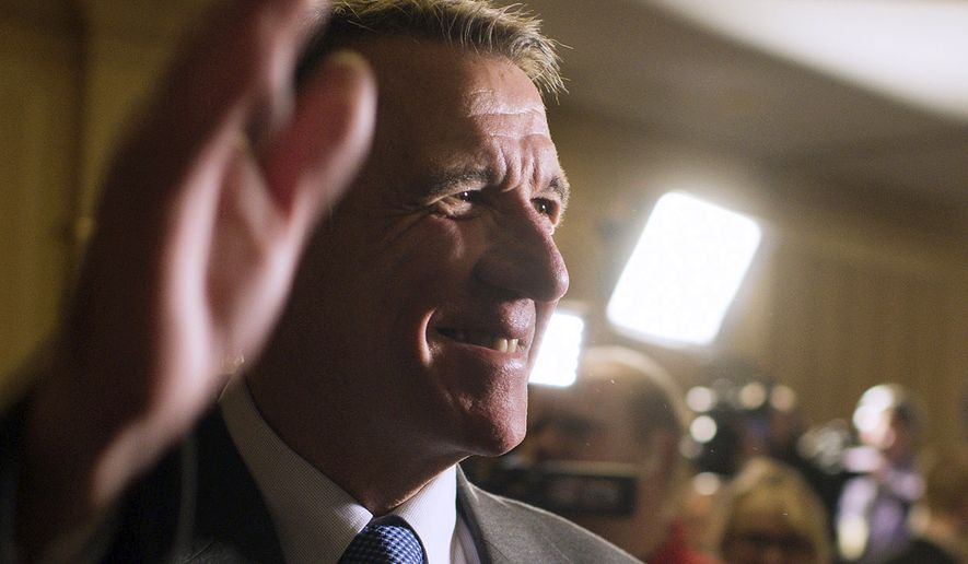 In this Nov. 8, 2016 file photo, Republican gubernatorial candidate Phil Scott waves to a room full of supporters as he awaits the election results at the Sheraton Burlington Hotel in South Burlington, Vt. The future of legalized recreational marijuana use in Vermont hinged Thursday, May 11, 2017, on a decision by Scott a day after the state Legislature became the first in the country to vote to legalize it. (AP Photo/Andy Duback, File)