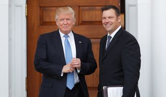 President Trump appointed Kansas Secretary of State Kris W. Kobach to join Vice President Mike Pence in leading a commission to study voter fraud and suppression. (Associated Press/File)