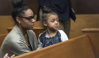 """FILE - In this Wednesday, April 12, 2017, file photo, Shayanna Jenkins Hernandez, fiancee of former New England Patriots tight end Aaron Hernandez, sits in the courtroom with the couple's daughter during jury deliberations in Hernandez's double-murder trial at Suffolk Superior Court in Boston. Jenkins-Hernandez said in an interview on """"Dr. Phil"""" scheduled to air May 2017 that she thought """"some cruel person"""" was playing a trick on her when she heard Hernandez hand hanged himself in his prison cell on April 19, days after he was acquitted of a double murder. He was still serving a life sentence for another killing. (Keith Bedford/The Boston Globe via AP, Pool, File)"""