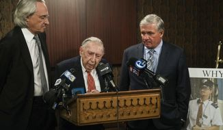 Attorneys Thomas Kline, left, Richard Sprague and Robert Mongeluzzi take part in a news conference while standing next to a photo of train engineer Brandon Bostian in Philadelphia, Thursday, May 11, 2017. A Philadelphia judge has ordered prosecutors to criminally charge the speeding Amtrak engineer involved in a 2015 derailment that killed eight people and injured about 200.   (AP Photo/Matt Rourke)