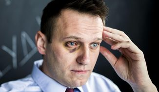 Russian opposition leader Alexei Navalny sits in his office in Moscow, Russia, Thursday, May 11, 2017. Russian opposition leader Alexei Navalny says that he has undergone eye surgery in Spain after being attacked last month. Navalny suffered a severe chemical burn in his right eye last month when an attacker doused him with green antiseptic. (Evgeny Feldman/Pool Photo via AP)