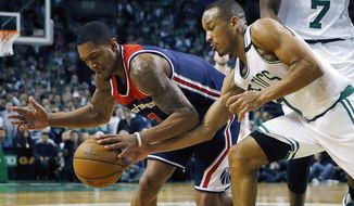 FILE - In this April 30, 2017, file photo, Boston Celtics' Avery Bradley, right, knocks the ball away from Washington Wizards' Bradley Beal during the fourth quarter of a second-round NBA playoff series basketball game, in Boston. As much as Isaiah Thomas has been the engine for the Celtics on offense this postseason, Avery Bradley has been counted on just as much on the defensive side of the ball. (AP Photo/Michael Dwyer, File)