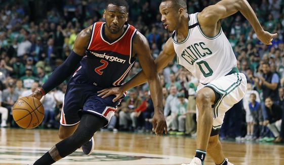 FILE - In this April 30, 2017, file photo, John Wall (2) drives against Boston Celtics' Avery Bradley (0) during the third quarter of a second-round NBA playoff series basketball game, in Boston. As much as Isaiah Thomas has been the engine for the Celtics on offense this postseason, Avery Bradley has been counted on just as much on the defensive side of the ball. (AP Photo/Michael Dwyer, File)