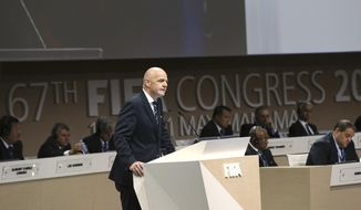 "FIFA President Gianni Infantino, left, speaks during the FIFA Congress, in Manama, Bahrain, Thursday, May 11 2017. Addressing his second congress of soccer nations as FIFA president, Infantino lambasted ""fake news"" following criticism of his leadership. Infantino didn't cite any reports but it comes in the week ethics judge Hans-Joachim Eckert and FIFA prosecutor Cornel Borbely denounced the decision to remove them from their posts. (AP Photo)"