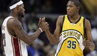 FILE - In this Jan. 8, 2008, file photo, Cleveland Cavaliers' LeBron James, left, greets Seattle Supersonics' rookie Kevin Durant (35) before an NBA basketball game, in Cleveland. LeBron James and Kevin Durant have squared off 23 times, with James holding an 18-5 edge. (AP Photo/Mark Duncan, File)