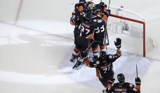 The Anaheim Ducks celebrate s 2-1 win over the Edmonton Oilers in Game 7 of a second-round NHL hockey Stanley Cup playoff series in Anaheim, Calif., Wednesday, May 10, 2017. (AP Photo/Chris Carlson)