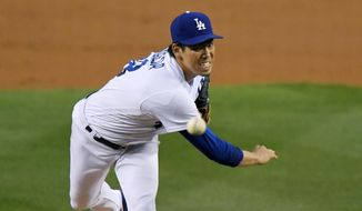 Los Angeles Dodgers starting pitcher Kenta Maeda watches a delivery during the second inning of the team's baseball game against the Pittsburgh Pirates, Wednesday, May 10, 2017, in Los Angeles. (AP Photo/Mark J. Terrill)