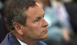 FILE- In this June 24, 2015, file photo, Nashville district attorney Glenn Funk watches the proceedings during the Vanderbilt Rape Trial in Nashville, Tenn. At a news conference Thursday, May 11, 2017, Funk said Officer Josh Lippert had a sufficient claim of self-defense when he shot and killed Jocques Scott Clemmons following a traffic stop. (George Walker IV/The Tennessean via AP, File)