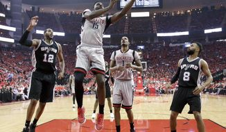 Houston Rockets center Clint Capela (15) shoots as San Antonio Spurs forward LaMarcus Aldridge (12) and guard Patty Mills (8) watch during the first half in Game 6 of an NBA basketball second-round playoff series, Thursday, May 11, 2017, in Houston. (AP Photo/Eric Christian Smith)