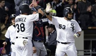 Chicago White Sox's Melky Cabrera (53) is greeted by Omar Narvaez (38 after) hitting a three-run home run against the Minnesota Twins during the fifth inning of a baseball game, Thursday, May 11, 2017, in Chicago. (AP Photo/David Banks)