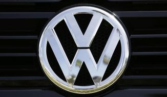 FILE - This Sept. 21, 2015, file photo, shows the Volkswagen logo on a car for sale at New Century Volkswagen dealership in Glendale, Calif. On Thursday, May 11, 2017, a federal judge in San Francisco approved a $1.2 billion settlement with owners of about 88,500 Volkswagens with 3-liter diesel engines rigged to cheat on emissions tests. (AP Photo/Damian Dovarganes, File)