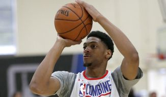 Justin Jackson, from Maryland, participates in the NBA draft basketball combine Friday, May 12, 2017, in Chicago. (AP Photo/Charles Rex Arbogast) **FILE**