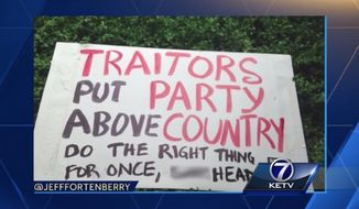 U.S. Rep. Jeff Fortenberry scolded protesters Thursday evening for frightening his children after a profane sign showed up in his front yard. (KETV)