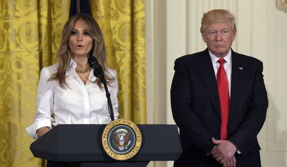 First lady Melania Trump, accompanied by President Donald Trump, speaks to military mothers during their visit to the White House in Washington, Friday, May 12, 2017, for a Mother's Day celebration in the East Room. (AP Photo/Susan Walsh)