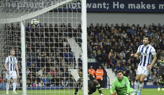 Chelsea's Michy Batshuayi, centre, scores a goal during the English Premier League soccer match between West Bromwich Albion and Chelsea, at the Hawthorns in West Bromwich, England, Friday, May 12, 2017. (AP Photo/Rui Vieira)