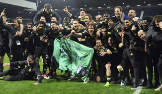 Chelsea's players and staff celebrate after the English Premier League soccer match between West Bromwich Albion and Chelsea, at the Hawthorns in West Bromwich, England, Friday, May 12, 2017. Chelsea won the match 0-1 meaning they win the Premiership title. (AP Photo/Rui Vieira)