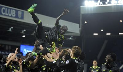 Chelsea's players throw Chelsea's N'Golo Kante in the air to celebrate after the English Premier League soccer match between West Bromwich Albion and Chelsea, at the Hawthorns in West Bromwich, England, Friday, May 12, 2017. Chelsea won the match 0-1 meaning they win the Premier League title. (AP Photo/Rui Vieira)