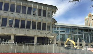 This April 3, 2017, photo shows the John E. Fogarty Building, a former government building in the Brutalist architectural style, in the middle stages of demolition in Providence, R.I. Brutalism, which got its name from a French word for raw concrete, has been sparking public battles ever since the architectural style flourished in the 1960s and 1970s, spawning buildings from Boston to Belgrade. (AP Photo/Matt O'Brien)
