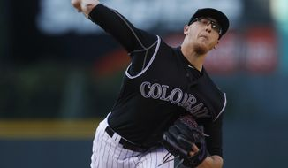 Colorado Rockies starting pitcher Jeff Hoffman delivers a pitch to a Los Angeles Dodgers batter during the first inning of a baseball game Thursday, May 11, 2017, in Denver. (AP Photo/David Zalubowski)