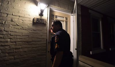 ADVANCE FOR WEEKEND EDITIONS - In this April 22, 2017, photo, Bethlehem Police Lt. Robert Lamana knocks on the door of a home in Bethlehem, Pa. Loud music was heard blocks away and young people were hanging around the area. Bethlehem Police and Lehigh University Police were working together patrolling off campus student housing along 5th and Morton Streets in Southside Bethlehem. (April Bartholomew/The Morning Call via AP)